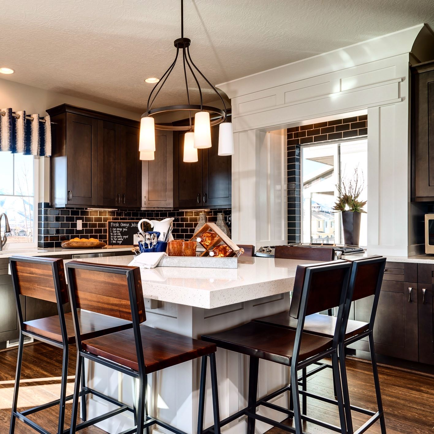 ... so many makes Oakwood Homes kitchens very family-friendly and comfortable for everyday living. We also adore the contrast between the cabinetry and trim ...