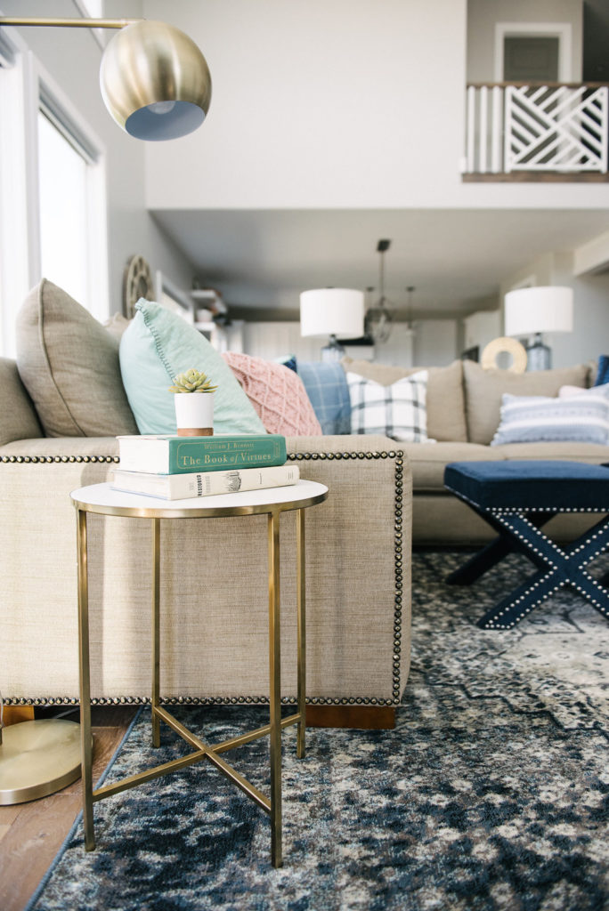 Beautiful family room with navy, mint, blush and neutral tones. Love the brass accents too!
