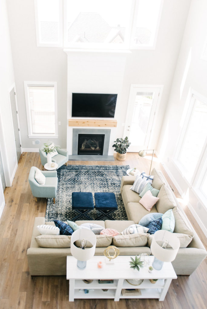 How awesome is this family room. The fireplace design with shiplap, natural wood and concrete is so modern and fresh, but also warm and cozy. Love this whole house!