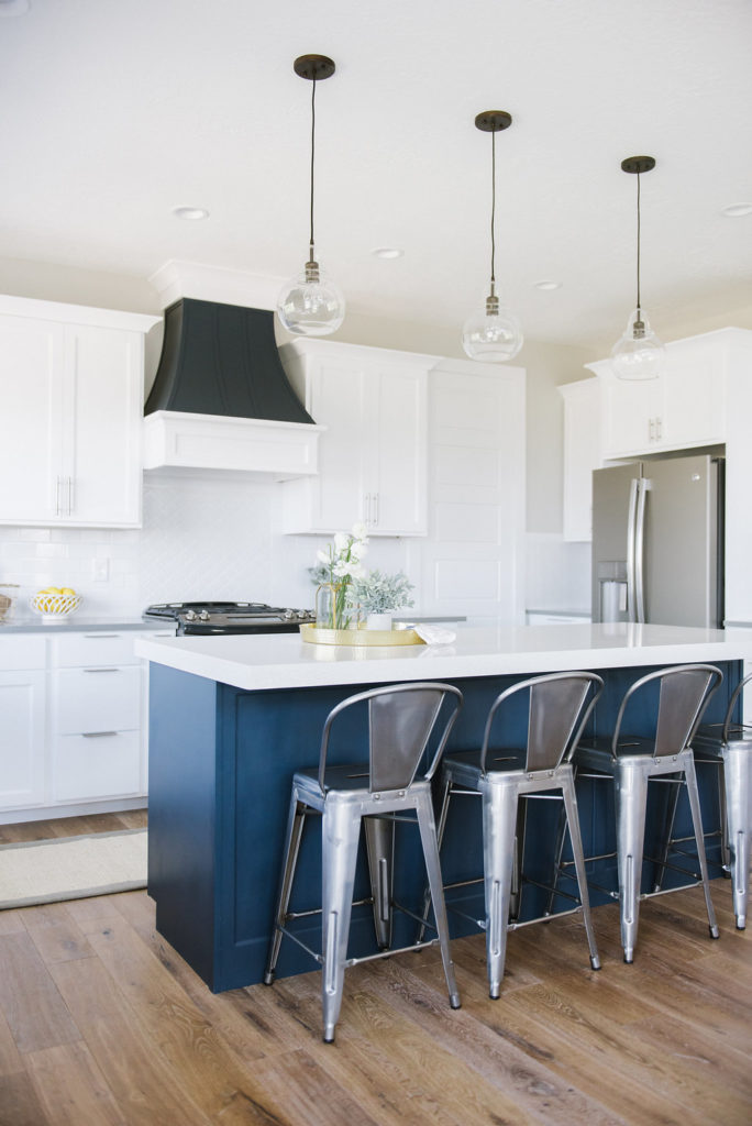 Gorgeous Modern kitchen with navy island! Love this whole house. See the full tour on DesignLovesDetail.com