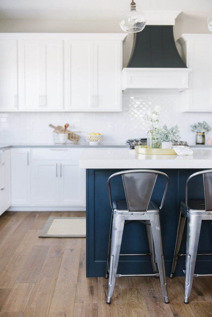 Beautiful White kitchen. This home was designed on a budget, but you would never know! See the full home tour at DesignLovesDetail.com!