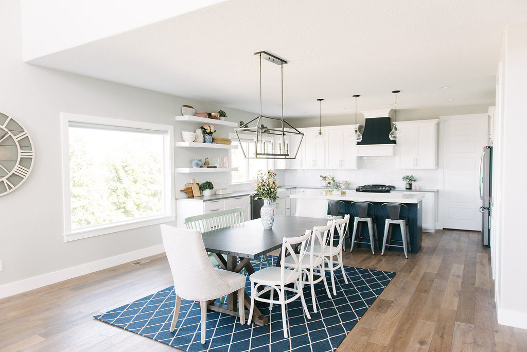 Navy and white kitchen and dining room space with a modern farmhouse feel