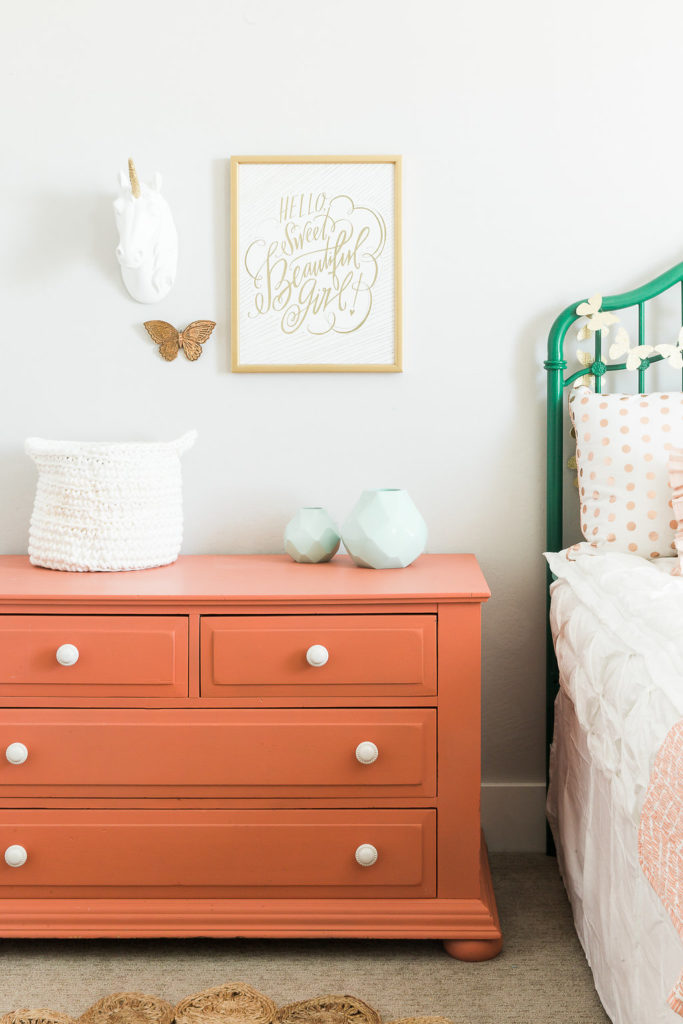 Girls room with coral dresser