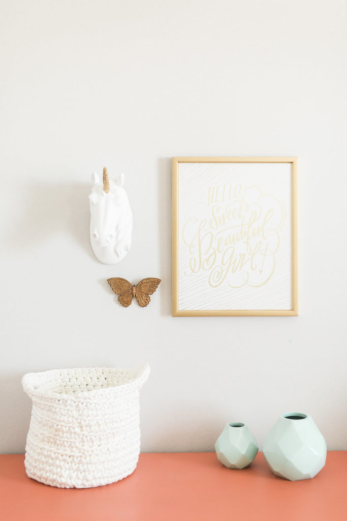Cute dresser and wall set up in kids room