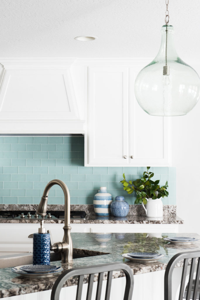 Love this seafoam green backsplash. The frosted glass is so stunning!