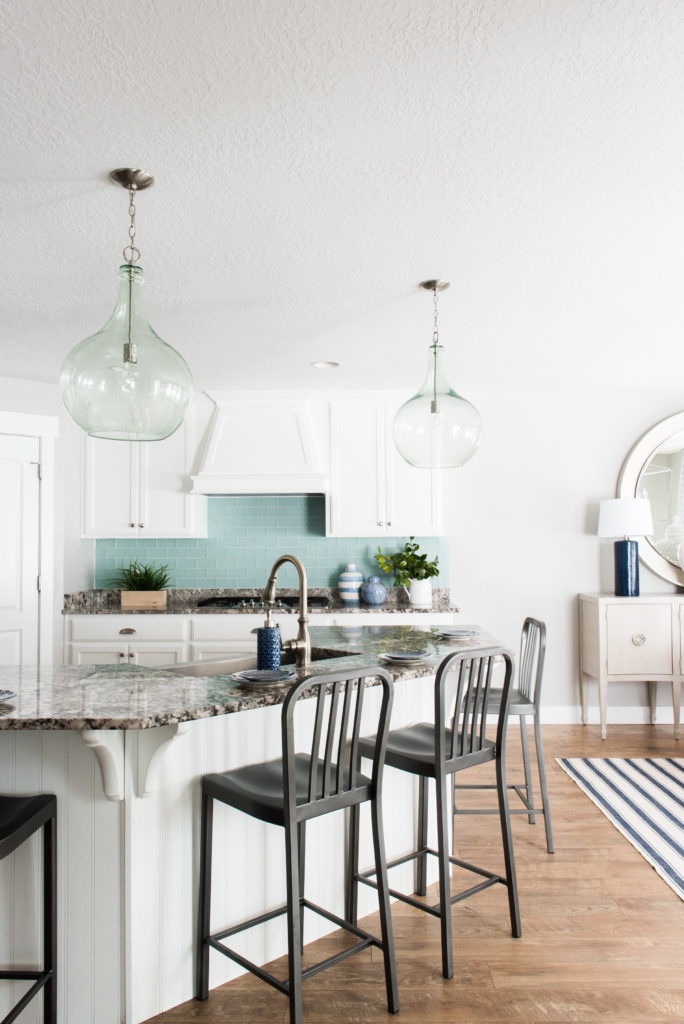 Frosted sea glass backsplash-- see the full home tour on DesignLovesDetail.com