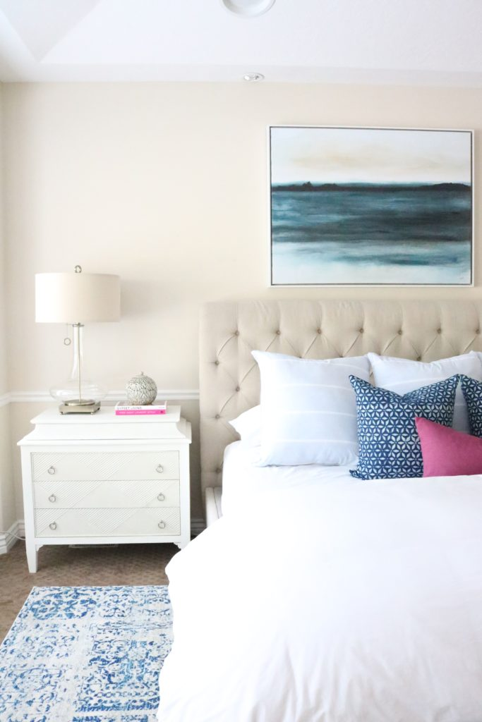 Master Bedroom with neutrals and blue. Modern Eclectic pop of color.