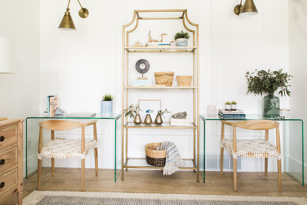 Love this office space! Glass desks with woven wood chairs and an chic etagere