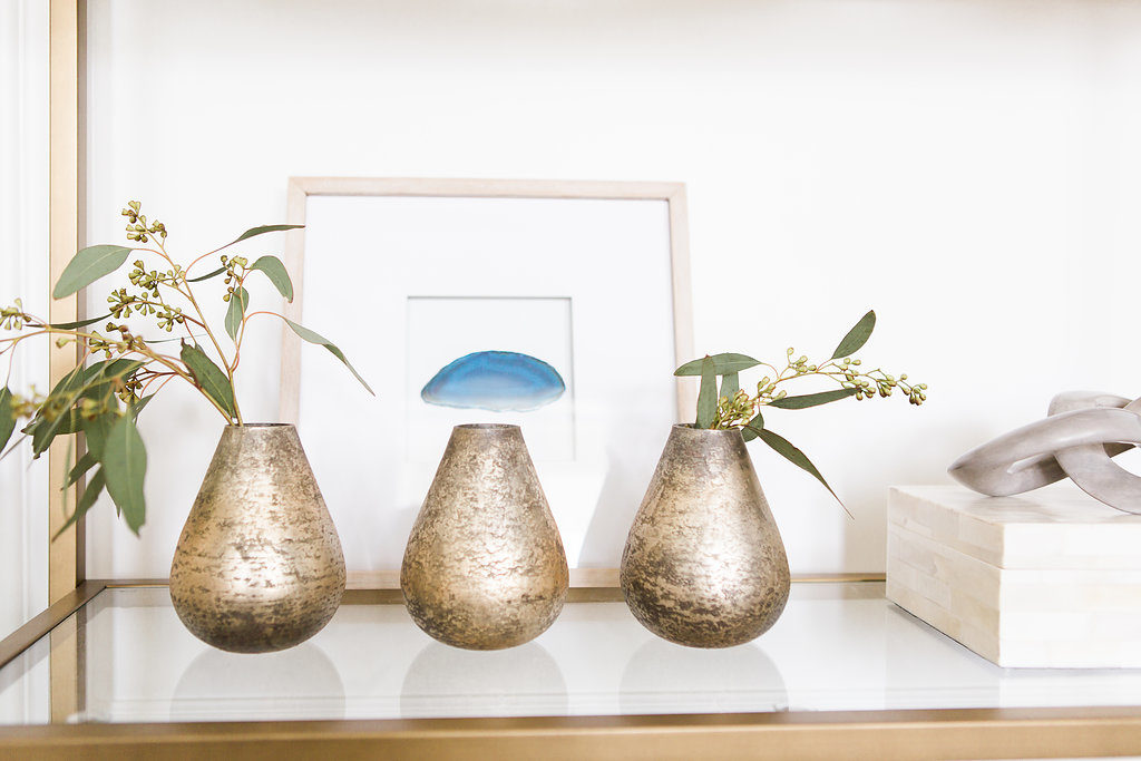 love these little vases-- tons of great styling ideas for open shelving