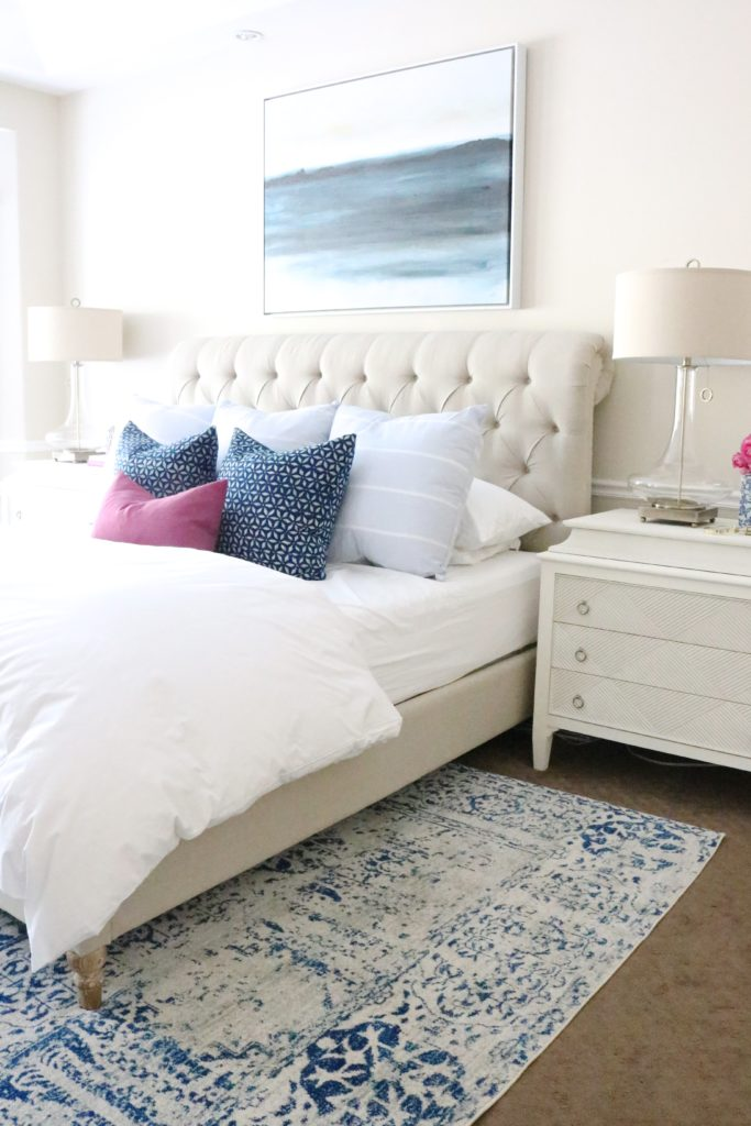 white, neutral, blue and fuchsia master bedroom. fresh, modern, traditional design. check out the full home tour!