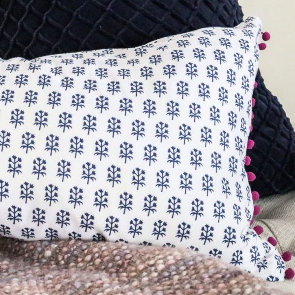 Pom Pom trim pillow cover. Hand stamped fabric from India
