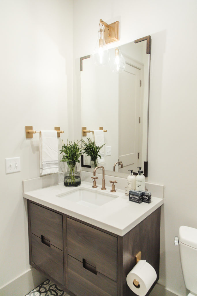 bathroom remodel with modern brass finishes