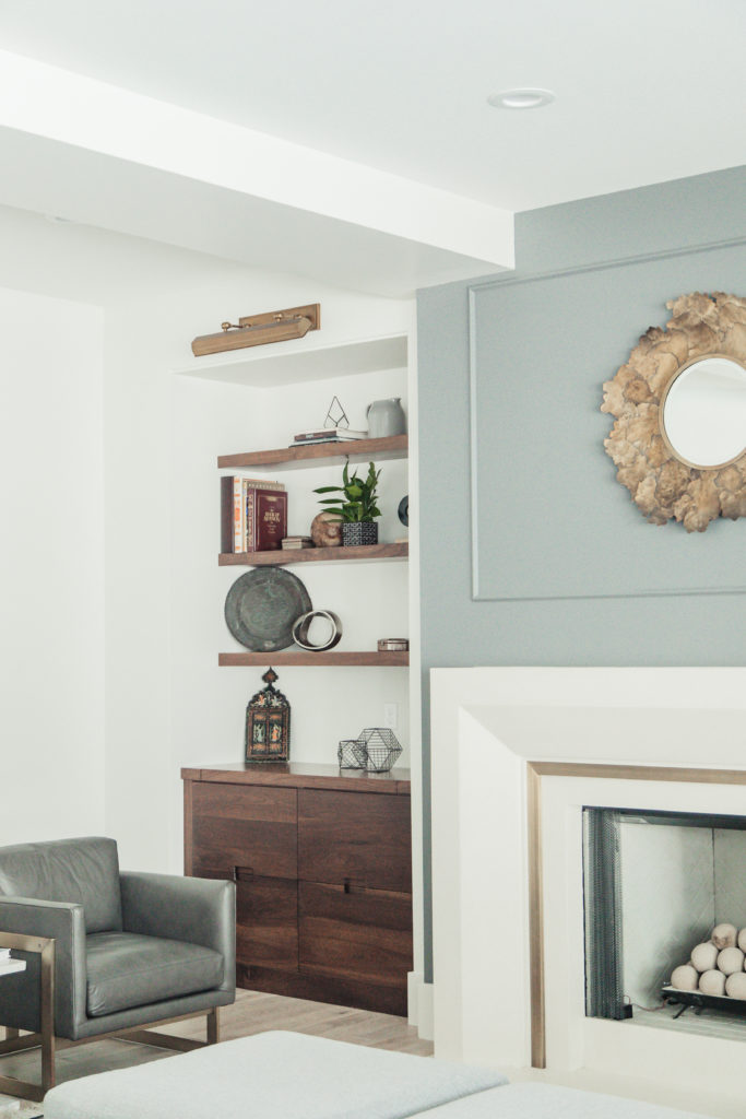 love these walnut built in bookshelves and pretty mantle fireplace that's classic and modern