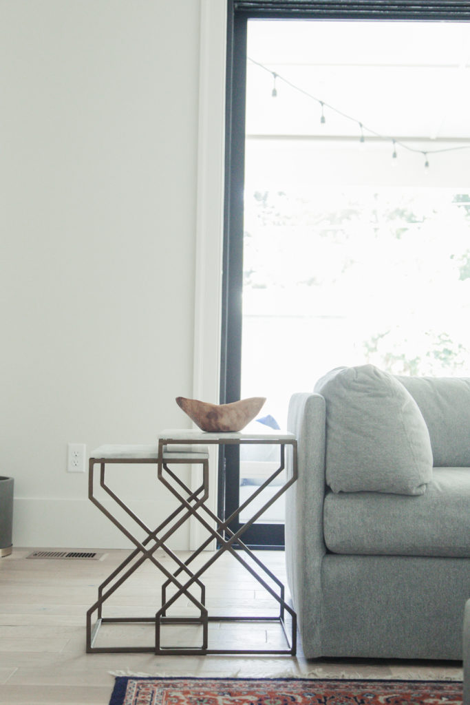 Love these fun nesting tables. Marble top with metal base, great style and shape