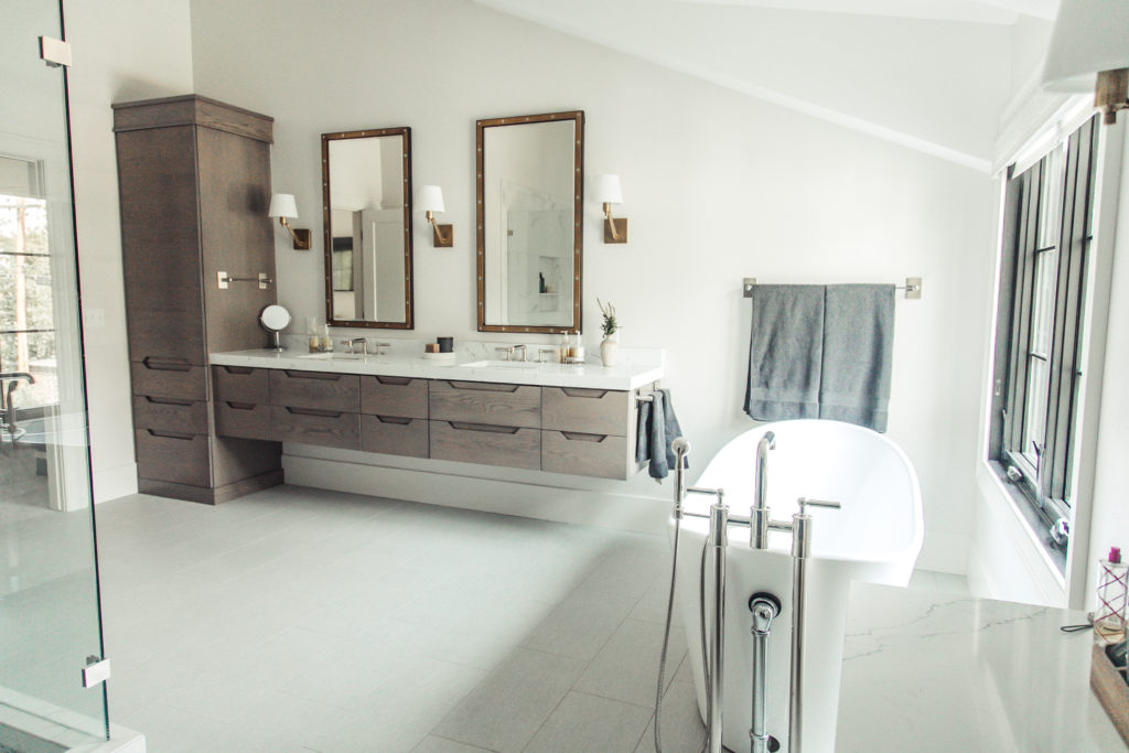 classic modern master bathroom with brass accents