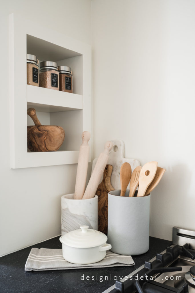 wood and marble accessories in the kitchen. Check out the full home tour!