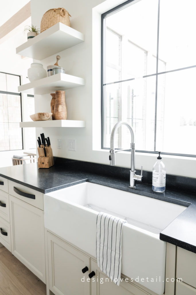 Love this pretty Delta faucet and open shelving in the kitchen